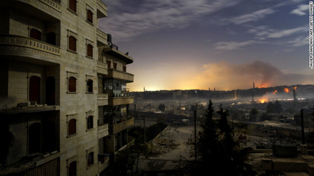 Smoke rises in the Hanano and Bustan al-Basha districts in Aleppo on December 1 as fighting continues through the night.