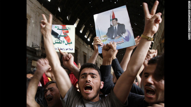 Syrians rally to show their support for President Bashar al-Assad in Damascus on April 30, 2011.