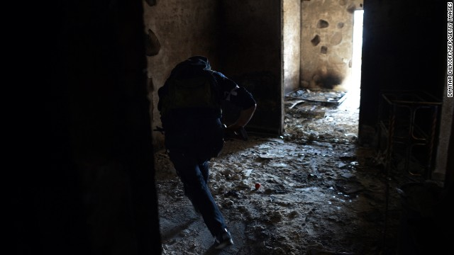 A rebel runs to avoid sniper fire from Syrian government forces in Aleppo on Thursday, April 11.