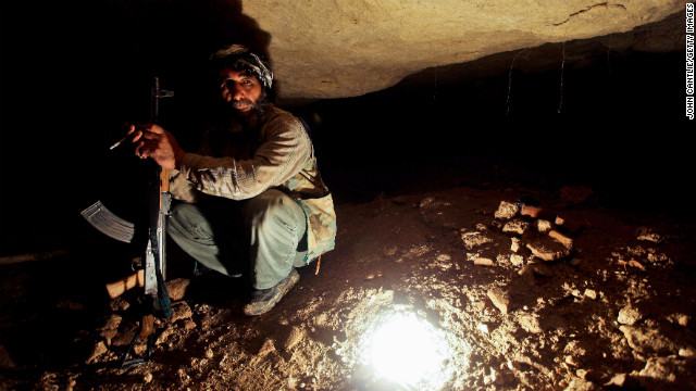 A Free Syrian Army member takes cover in underground caves in Sarmin on April 9.