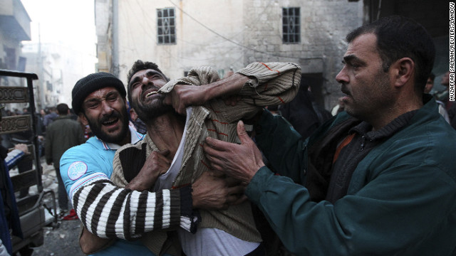 A father reacts after hearing of a shelling by forces loyal to Syria's President Bashar al-Assad in Aleppo on January 3.