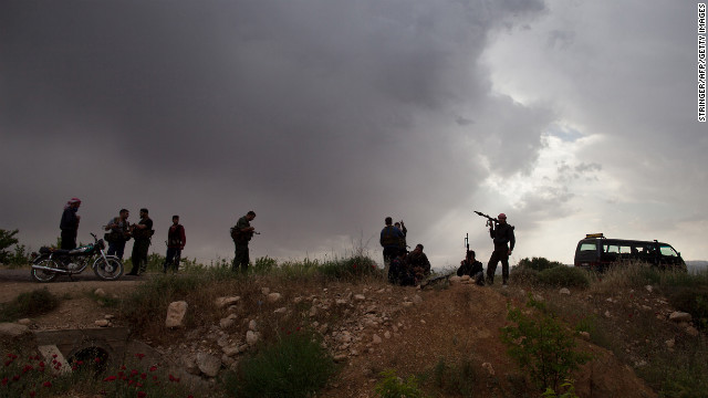 Syrian rebels take position near Qusayr on May 10.