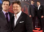 Basking in it: Russell Crowe and Henry Cavill, who portray Kryptonites in Man of Steel, attended the film's premiere on Monday in Madrid, Spain following its record-setting opening weekend