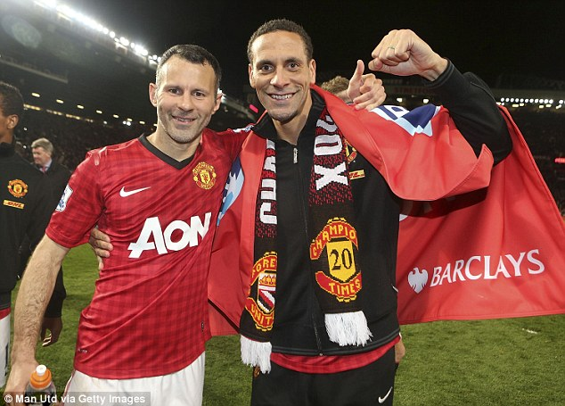 Party: Giggs (left) celebrates with Rio Ferdinand (right) after winning the 25th major medal of his career