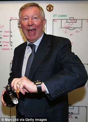 Take a drink: Ferguson cracks open a bottle of champagne and insists his latest title triumph has given him fresh impetus to carry on in the Manchester United hotseat