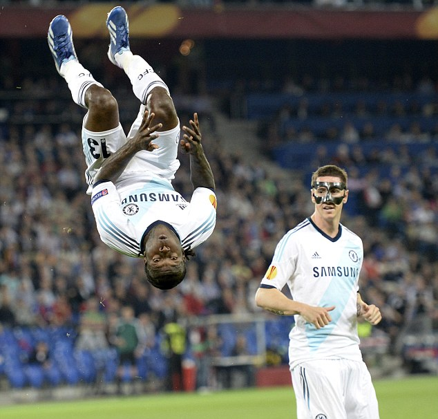 Breakthrough: Chelsea's Victor Moses (left) nodded the Blues ahead
