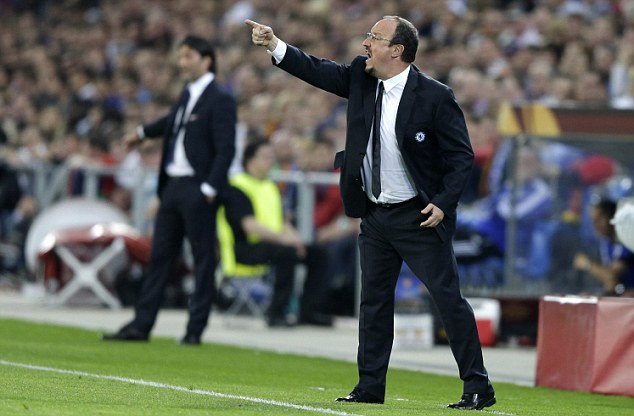 In control: Chelsea boss Rafael Benitez barks orders from the touchline