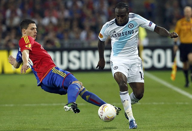 Launching in: Basle's Fabian Schar challenges Chelsea's Victor Moses