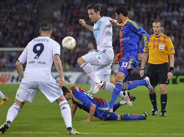 Leap into action: Frank Lampard dodges a challenge from two Basle defenders