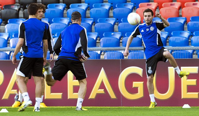 Left out? Juan Mata trains for Chelsea at Basle on the eve of their semi-final