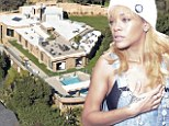 Police arrest 26-year-old man for walking on the roof of Rihanna's Los Angeles home