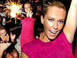 Pretty in pink! Kendra Wilkinson celebrates turning 28 in skintight cerise dress... (with a VERY big bottle of champagne)