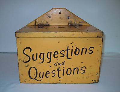 "Iron box with ""Suggestions and questions"" written on it"