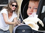 Snap happy! Gisele Bundchen clicks away with her camera phone as she takes her baby girl Vivien for a stroll around the historic Louvre in Paris