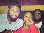Tragic: Lil Snupe - pictured here with his management team - was shot dead on Thursday morning