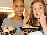 Look we're eating: Jourdan Dunn and Rosie Tapner make sure everyone know that they are happy to put a single chip in their mouth