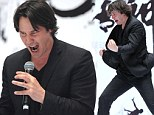 The Matrix reloaded! Keanu Reeves screams down a microphone and demonstrates intense Kung Fu moves at press conference for new film