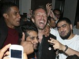 Say cheese: Chris Martin smiles for the many cameraphones with his fans outside Cafe de Paris in London