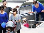 Make-up free Tiffani Thiessen and her daughter Harper splash around New York's Central Park during family outing