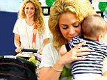 Back to mommy duty! A glowing Shakira cradles son Milan as she jets into Brazil following The Voice finale