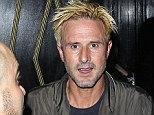 Off the wagon: David Arquette was spotted drinking in a bar after his divorce from Courteney Cox was finalised