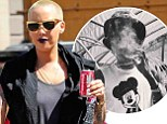 Smoking hot! Amber Rose lunches in a black outfit and purple lipstick... while her fiancé Wiz Khalifa chills out with a suspicious cigarette