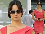 Pretty in pink: Bérénice Marlohe looks jaw-dropping in a short figure-hugging frock... clutching a cute penguin iPhone case