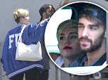 Rough and tumble girl! Miley Cyrus dons varsity jacket emblazoned with offensive acronym as she heads to recording studio