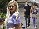 They're inseparable! Rita Ora takes time out from working on her album to spend the day shopping with beau Calvin Harris