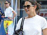 That's one way to stand out! Katie Holmes steps out in bold watercolour print maxi skirt after it's revealed she's struggled to find work