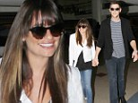 Harmonizing so well! Smiling Lea Michele holds hands with her man Cory Monteith as they arrive in Los Angeles