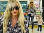 They grow up so fast! Kimberly Stewart holds little Delilah's hand as she confidently walks during trip to the supermarket