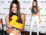 Kendall Jenner shows off her stomach at the Sugar Factory restaurant opening in New York on Thursday
