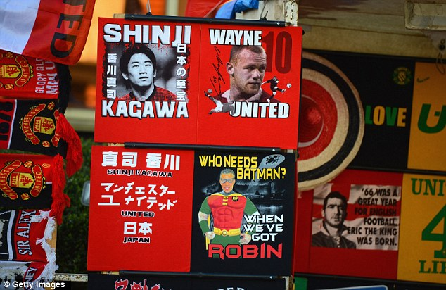 Novelty: Kagawa, Rooney and Van Persie are all represented at a T-shirt stand outside Old Trafford