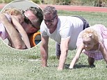 McSteamy's lil' workout buddy! Eric Dane does squats and push-ups alongside daughter Billie on family park outing