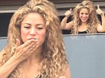 Thumbs up: Shakira greeted her fans on Friday from her hotel balcony in Rio de Janeiro, Brazil with the universal symbol of approval