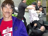 Taste the pain! Red Hot Chilli Peppers star Anthony Kieldis scuffles with Rolling Stones security guard outside posh hotel