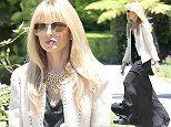 Keeping mum: Rachel Zoe, 41, fuels pregnancy rumours as she steps out in loose-fitting black dress