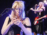 Rocking like it's 1994: Courtney Love puffs on cig as dress falls down during Philadelphia concert
