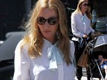 A tale of two styles! Uma Thurman mixes up her look in a fancy top and house pants as she treats her children Maya, Levon and Luna for a lunch date