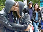 They're newlyweds after all! Keira Knightley cuddles and kisses her new husband James Righton on walk through drizzly Seattle
