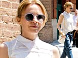 All covered up! Kylie Minogue hides her usually bare legs in baggy boyfriend jeans