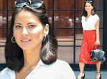 Lady in red! Olivia Munn makes over her 'hot' girl image and is prim and proper in a conservative blouse and long skirt