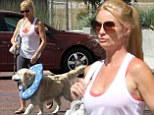 Nicollette Sheridan parades her pooch Oliver in a starry blue neck disk as she takes him out for a stroll in Malibu