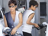 She's got this handled! Halle Berry shows off her growing bump as she pumps her own petrol
