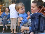 To be a kid again! Alyssa Milano clowns around with adorable tot Milo on family outing with the parents