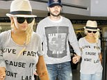 'Live Fast Cause It Won't Last'! Christina Aguilera's message is loud and clear as she races to catch a flight with her beau
