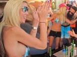 Doing what she does best! Tara Reid parties in her bikini with musician beau Erez Eisen
