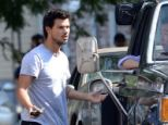 Making hjis case: Taylor Lautner pleaded with a tow truck driver on Friday while filming Tracers in New York City