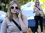 Getting it right! Mischa Barton flatters her figure in skin tight jeans as she enjoys a matinee movie by herself